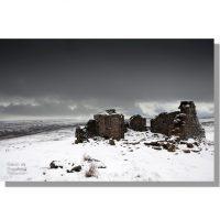 greets shooting house on snowy woodhall greets moor overshadowed by dark monochrome skies