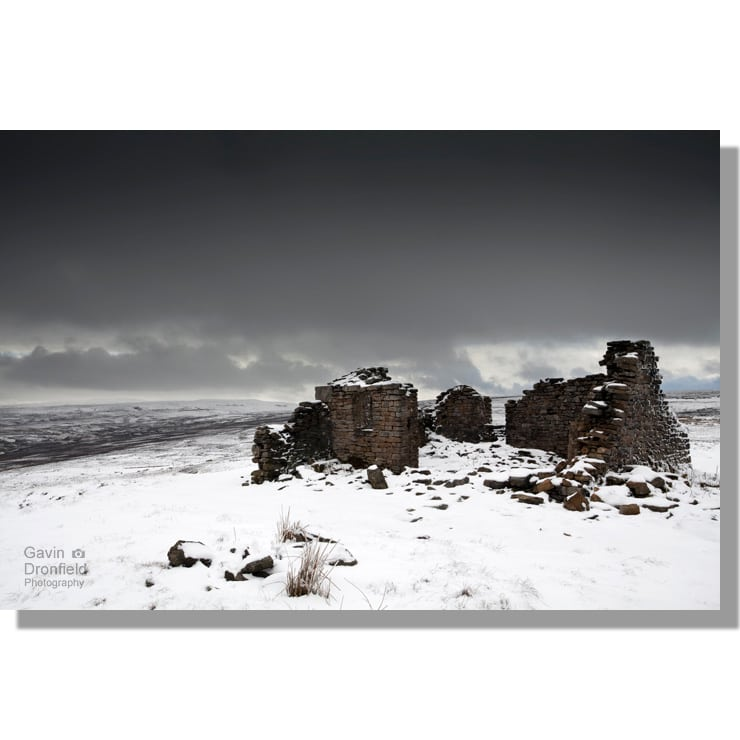 greets shooting house on snowy woodhall greets moor overshadowed by dark monochrome skies
