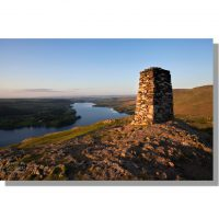 gorgeous clear summer sunset over Ullswater from Hallin Fell summit trig point