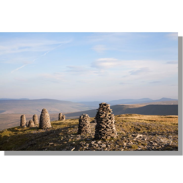 evening view of yorkshire three peaks from stone cairns / stone men on wild boar fell