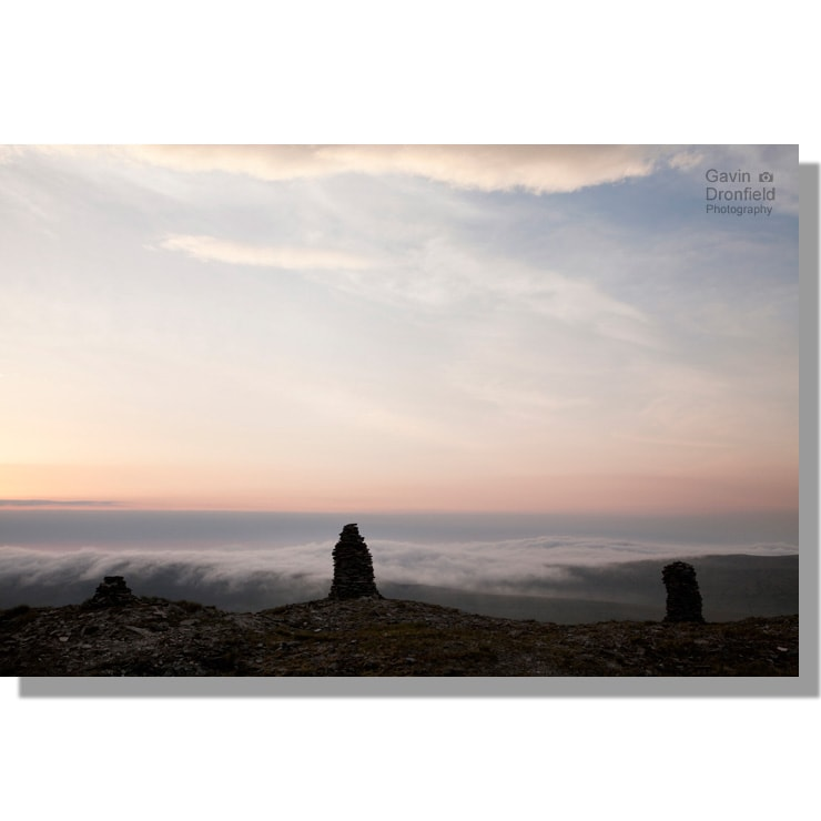wild boar fell silhouetted stone men at red dawn above mallerstangdale