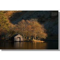 atmospheric wast water boathouse catching the last golden light of day at sunset