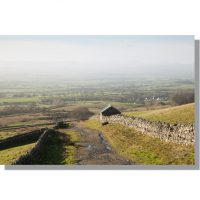 dufton village in the eden valley bathed in winter sunshine from the pennine way track near bow hall