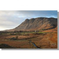 buckbarrow crags red under blue cloudy sky turn red during winter sunset