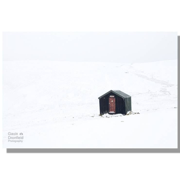 great lingy hut on a snow covered great lingy hill under white cloudy skies