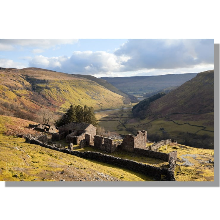 ruined farmhouse at crackpot hall overlooking bend in river swale valley under late winter sun