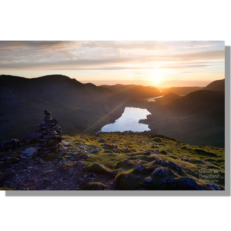 colourful summer sunset over Buttermere Valley from Fleetwith Pike with sunburst