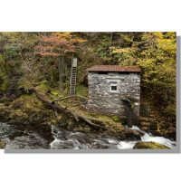 stone small scale hydroelectric plant on river brathay amidst colourful autumnal colwith woods