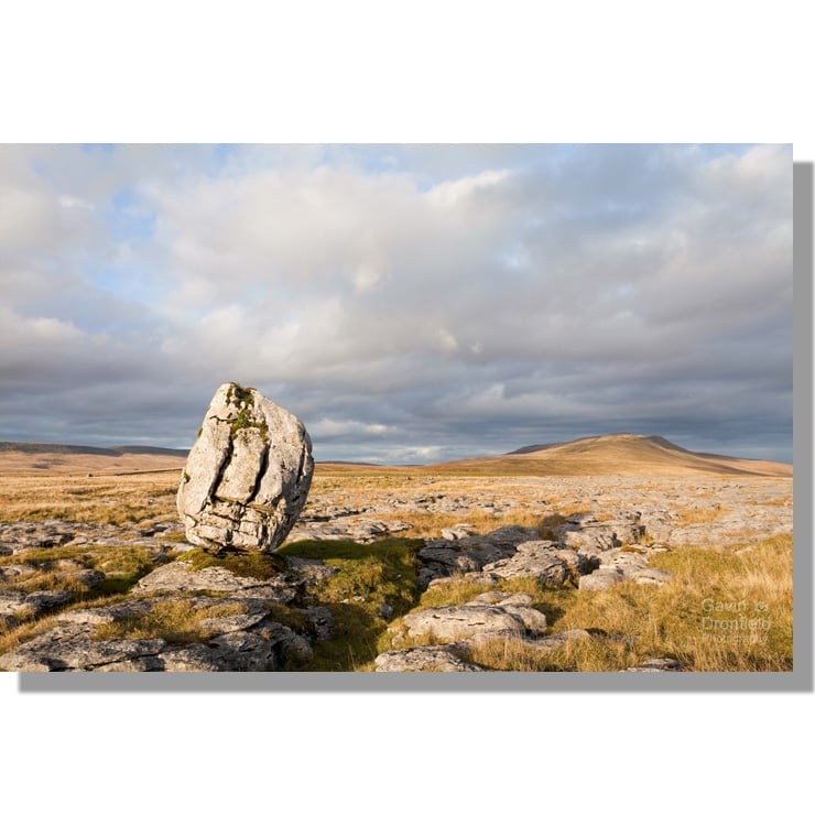 Whernside from limestone erratic on Scales Moor limestone pavement under cloudy skies