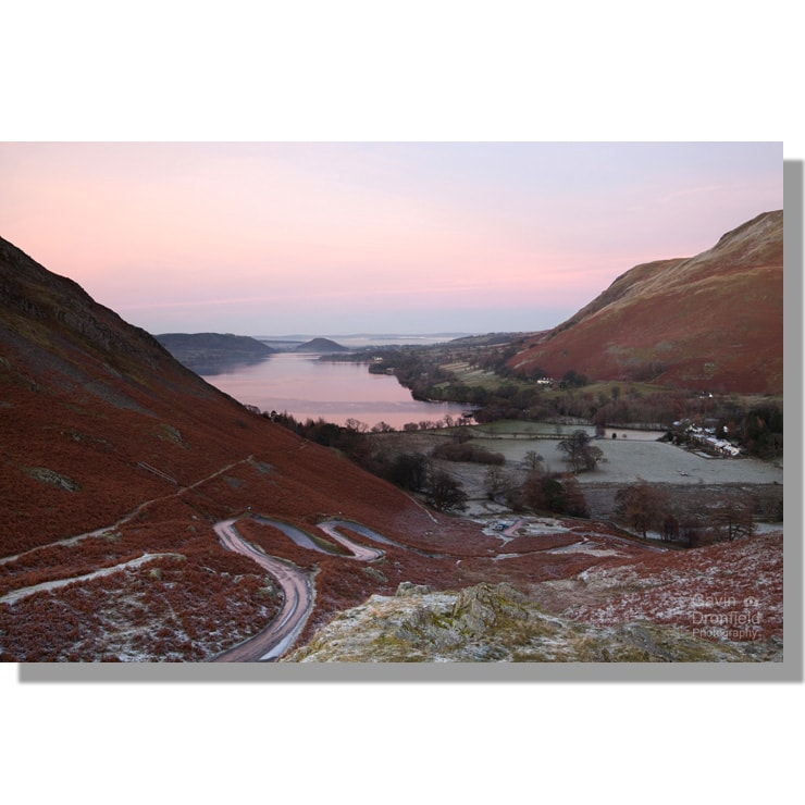 martindale hause view over ullswater and road zigzagging up climb under red sunset skies