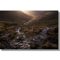 lingmell beck valley from footpath down from styhead catching dramatic last light before sunset