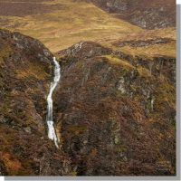 low force waterfall where pudding beck flows over force crag covered in winter hues