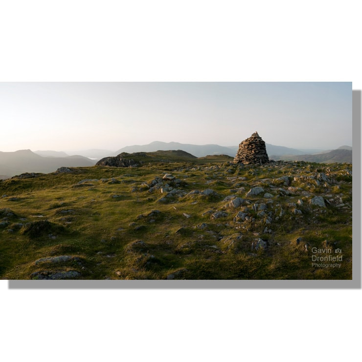 panoramic view from cairn on high spy summit at sunset under clear skies looking towards distant skiddaw