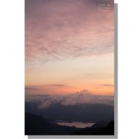 derwent water under dramatic colourful clouds in orange dawn sky from allen crags