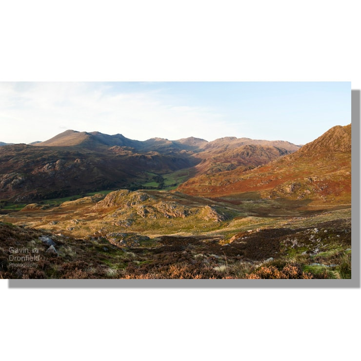 scafell massif ridge ringing head of eskdale valley coloured in rich autumnal colours under setting sun