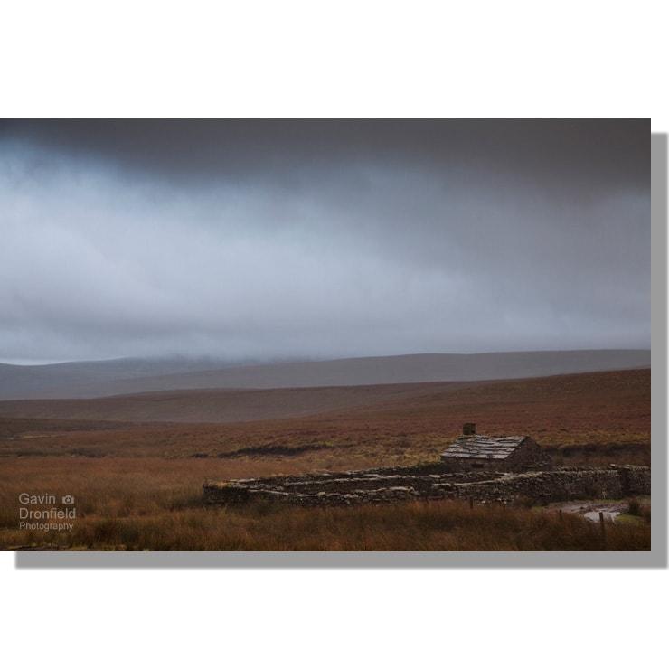 black scar house shepherds hut on remote birkdale common moor under ominous dark grey skies