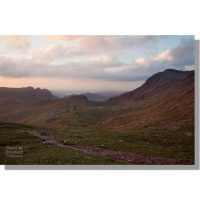 footpath from esk hause towards bow fell, langdale pikes and tongue head in soft dawn light