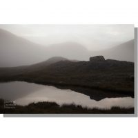 misty monochrome view from unnamed tarn on tongue head in dwindling light of dusk