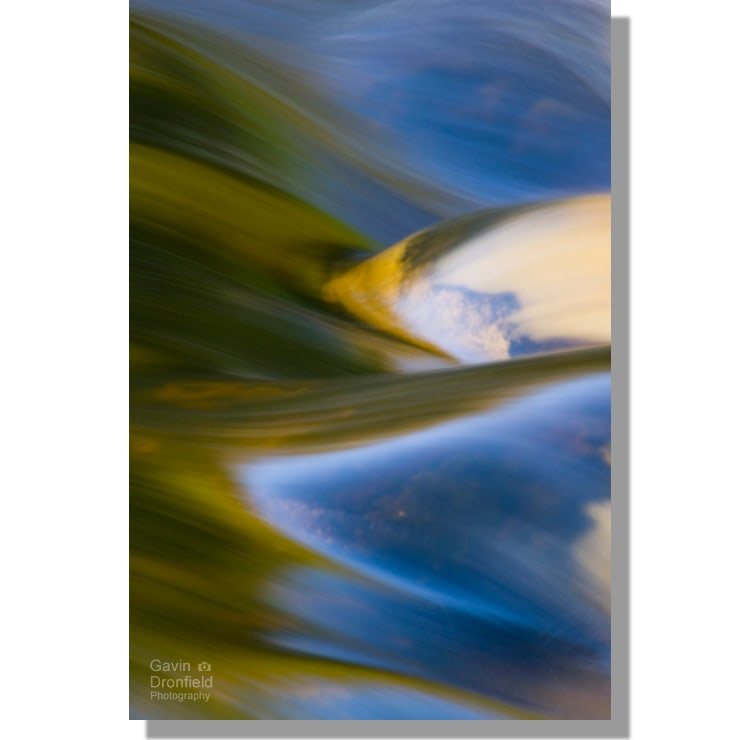 River Wharfe rapids abstract at Bolton Abbey weir