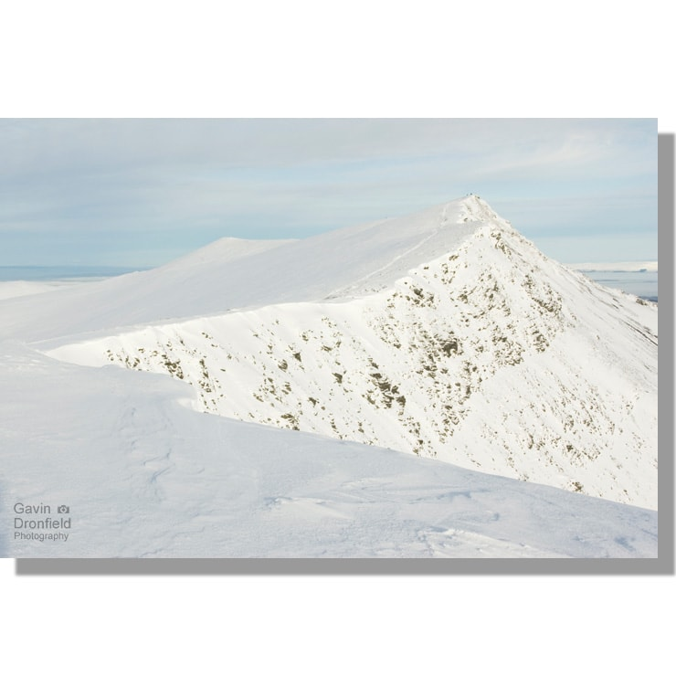 Snow cornice on Blencathra summit ridge